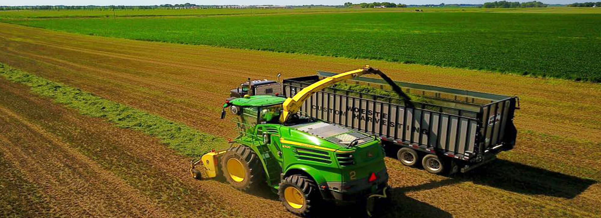 Modern John Deere chopper in hay field