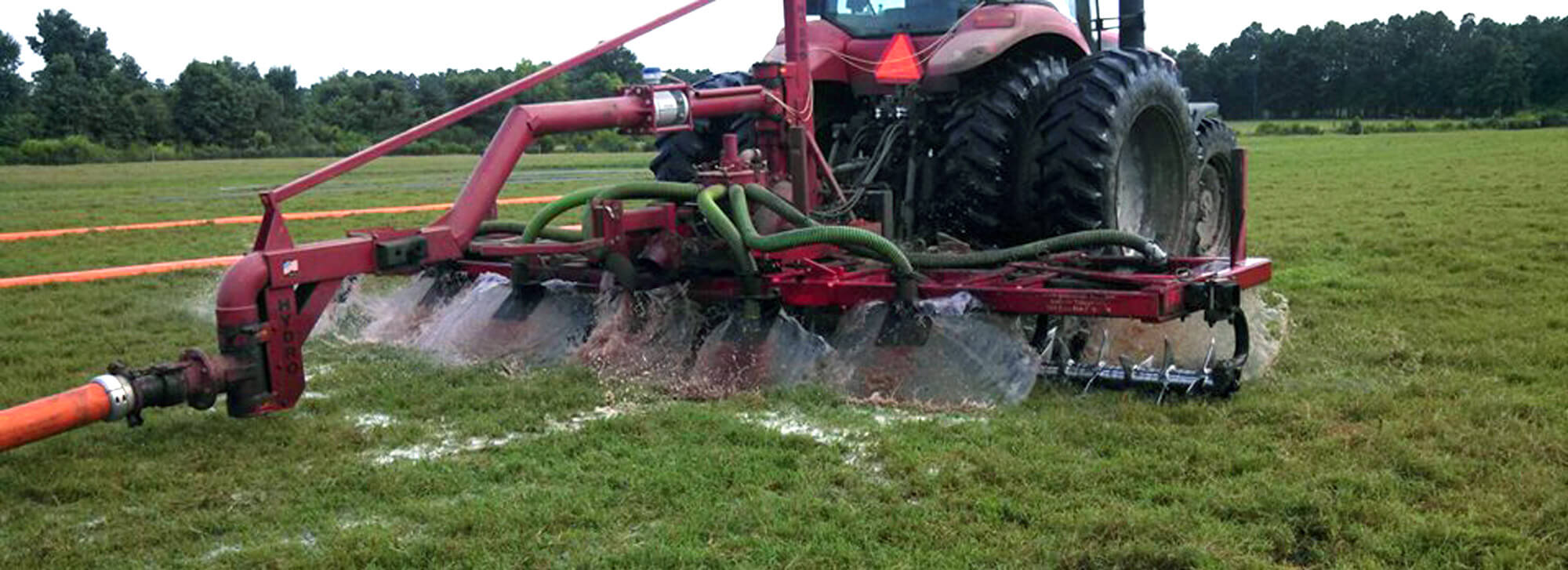 Direct manure injectors behind a large tractor